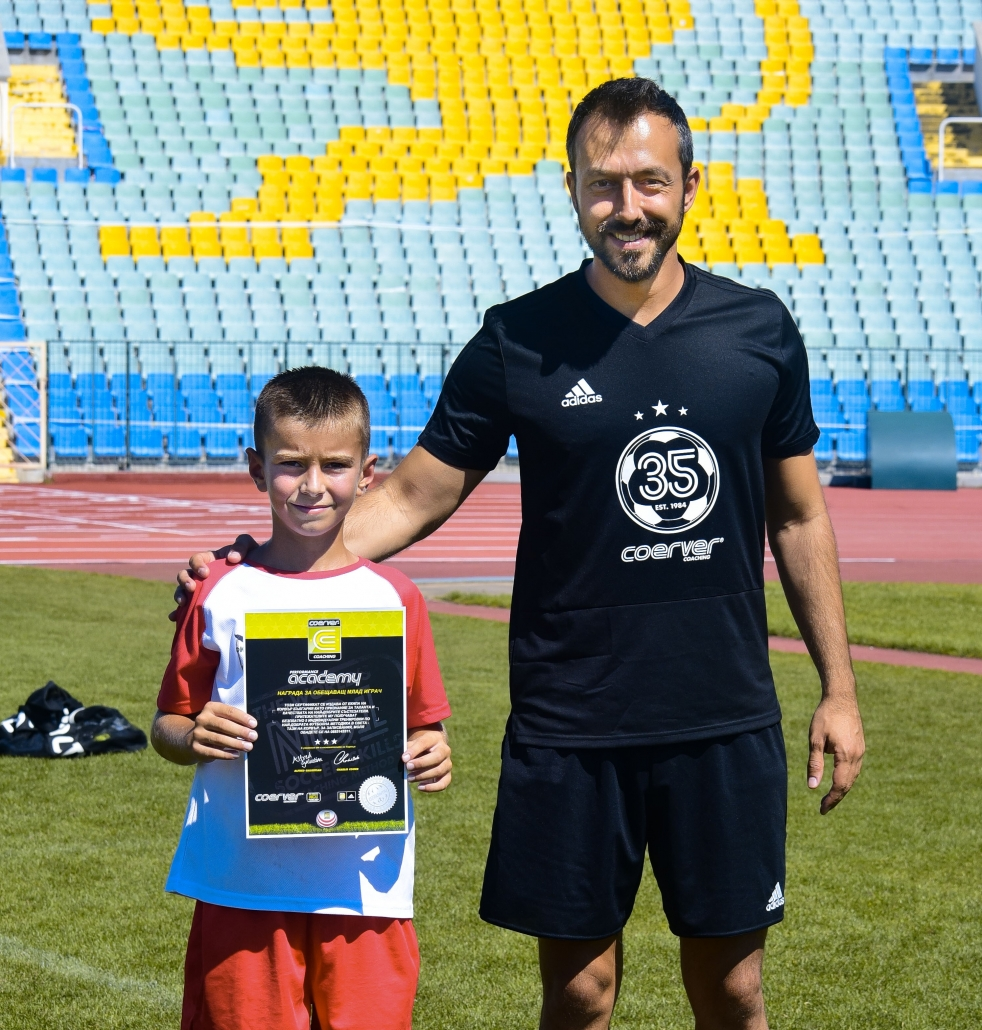 Georgi Zahariev giving an award to a talented kid